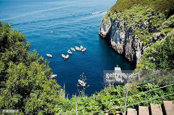 boats outside the blue grotto, capri, italy - capri stock pictures, royalty-free photos & images