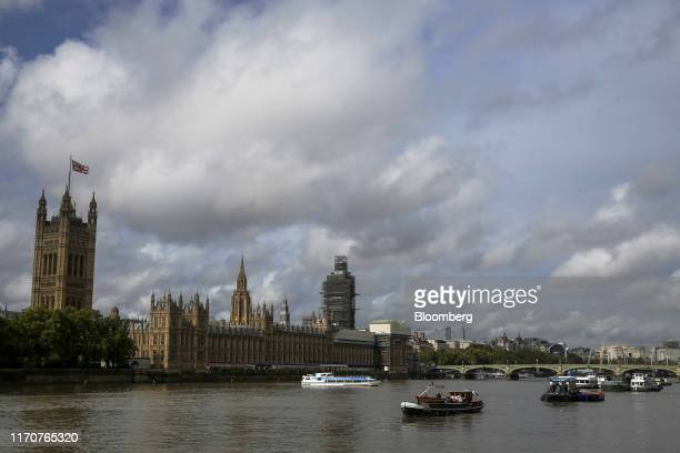 Boats pass the Houses of Parliament as they travel along the River Thames in London UK on Tuesday Sept 24 2019 In a sweeping rebuke to the prime...