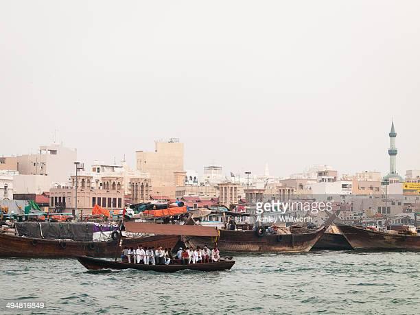 Boats ply the busy Dubai Creek in the city of Dubai, United Arab Emirates
