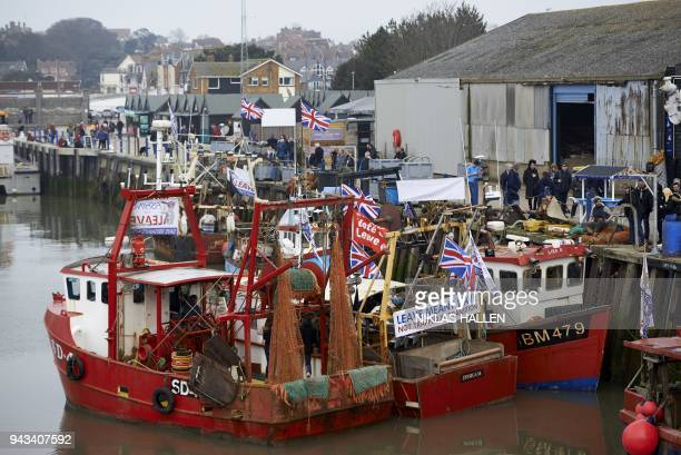 Boats prepare to depart during a demonstration in Whitstable southeast England on April 8 2018 against the Brexit transition deal that would see...