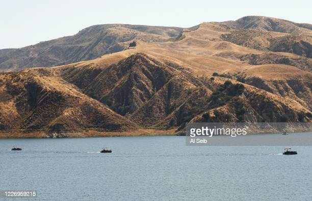 Boats return with rescuers on Lake Piru as it is learned Ventura County Sheriff's Search and Rescue dive team located a body Monday morning in Lake...