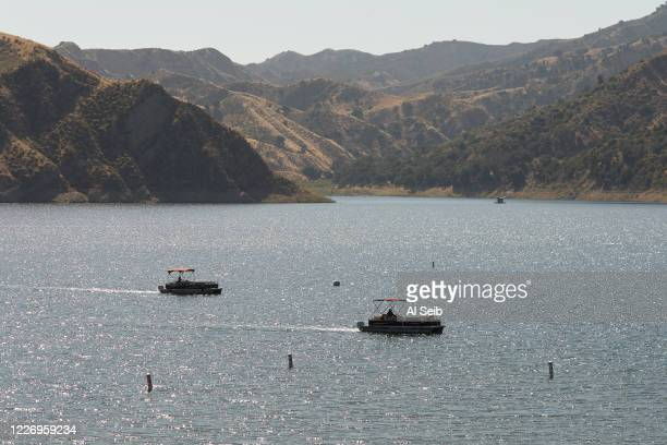Boats return with rescuers on Lake Piru as it is learned Ventura County Sheriffs Search and Rescue dive team located a body Monday morning in Lake...