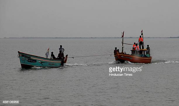 Boats returning on the Jakhu Bandar port as Cyclone Nilofer is expected to hit the coast on October 30, 2014 in Naliya, India. According to India...