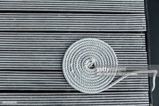 boats rope coiled into circle on boardwalk