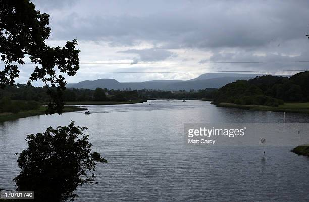 Boats sail in water close to the Kellyhevlin Hotel which is being used as the G8 media centre close to the G8 venue of Lough Erne on June 16 2013 in...