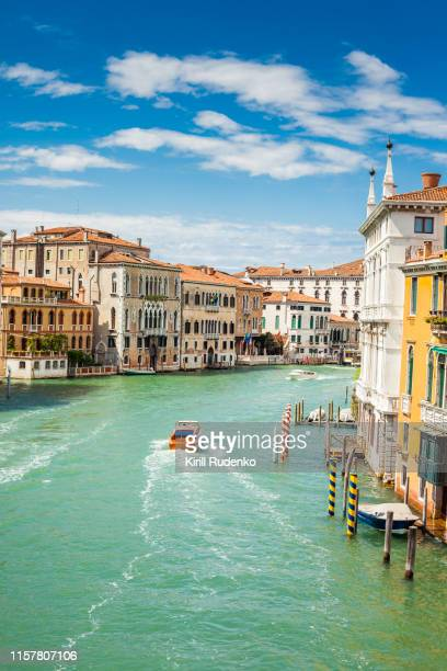 boats sailing in grand canal on a bright summer day - venice italy stock pictures, royalty-free photos & images