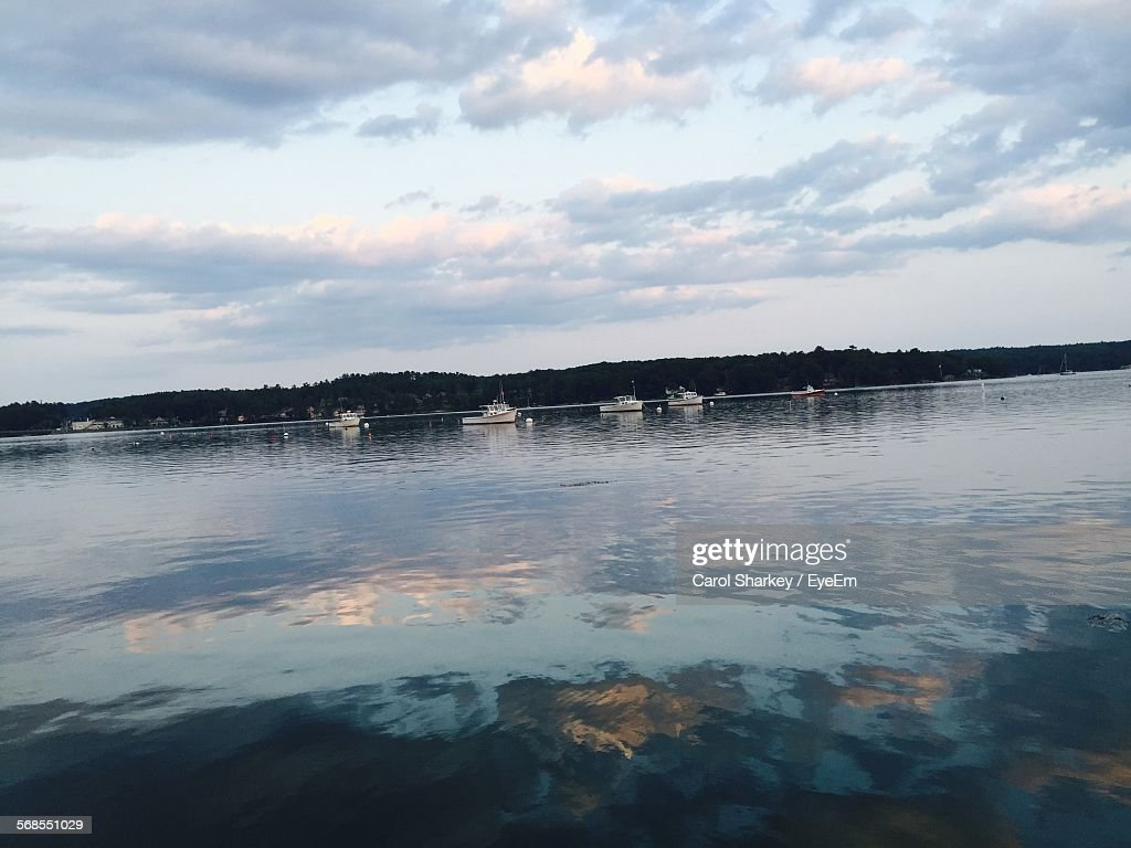 Boats Sailing In River Against Cloudy Sky : Stock Photo