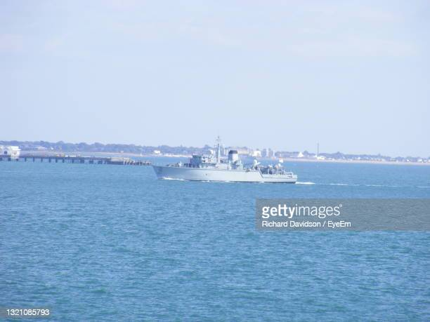 boats sailing in sea against clear sky - portsmouth england stock pictures, royalty-free photos & images