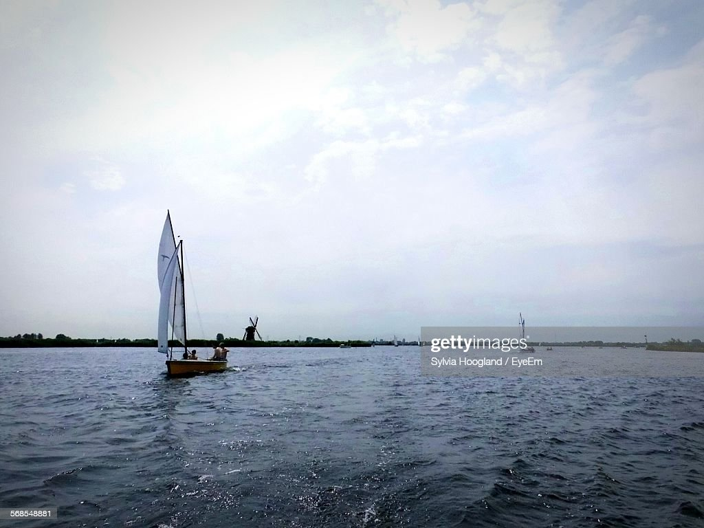 Boats Sailing In Sea Against Cloudy Sky : Stock Photo