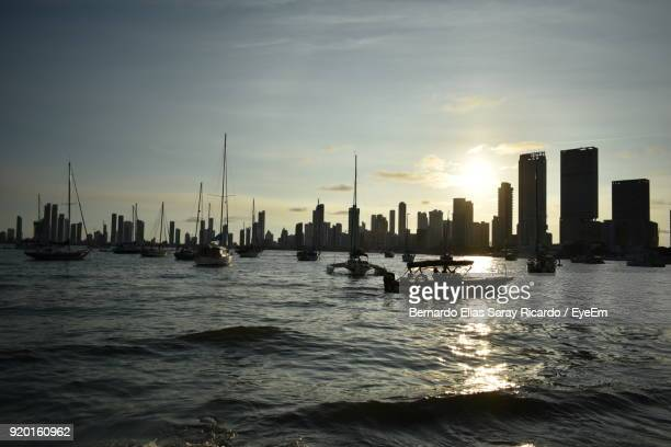 Boats Sailing In Sea Against Sky During Sunset