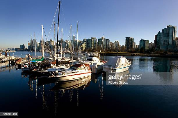 Boats sit at their docks with the skyline in the background February 19 2009 in Vancouver British Columbia Canada Vancouver is the host city for the...