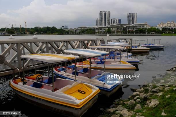 Boats sit by a jetty at Putrajaya Lake in Putrajaya Malaysia on Wednesday Sept 23 2020 Malaysias Prime Minister Muhyiddin Yassin urged people to...