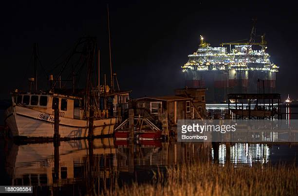 Boats sit docked as the Chevron Corp Jack St Malo semisubmersible drilling and production platform is transported to the Gulf of Mexico from Kiewit...