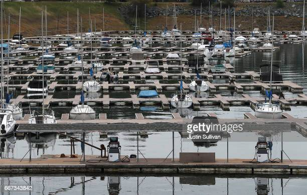 Boats sit docked at the Folsom Lake Marina sit on the dry lakebed of Folsom Lake on April 11 2017 in El Dorado Hills California After record rainfall...