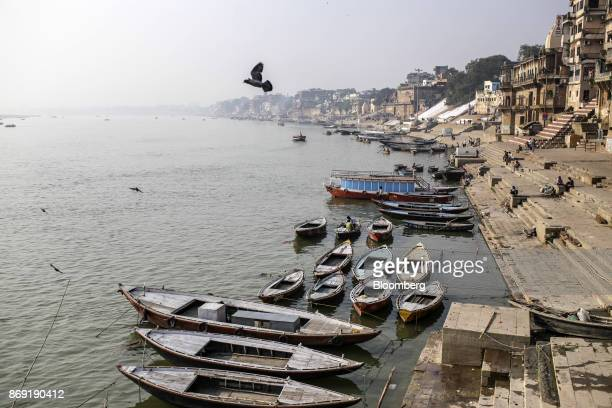 Boats sit docked by the banks of the Ganges river in Varanasi Uttar Pradesh India on Saturday Oct 29 2017 A big drop in borrowing costs for Indian...