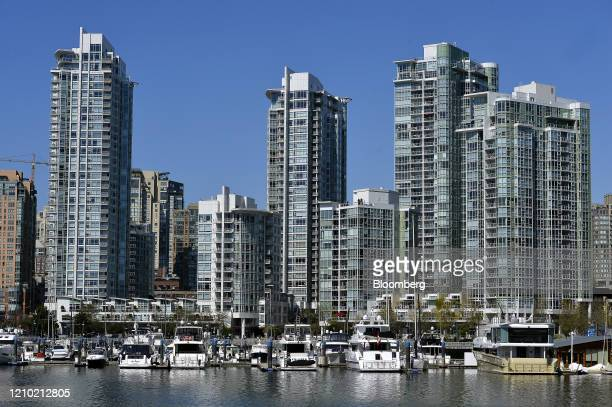 Boats sit docked in front of redidential buildings in the Yaletown neighbourhood of Vancouver British Columbia Canada on Thursday April 16 2020 As...