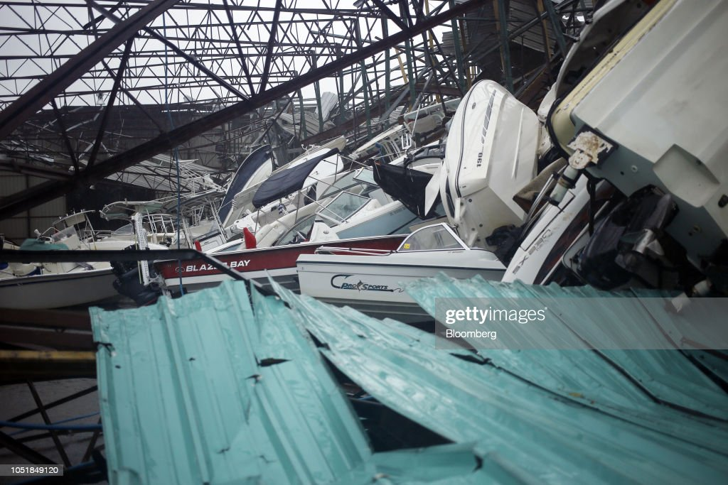 Boats Sit In A Storage Warehouse Damaged From Hurricane