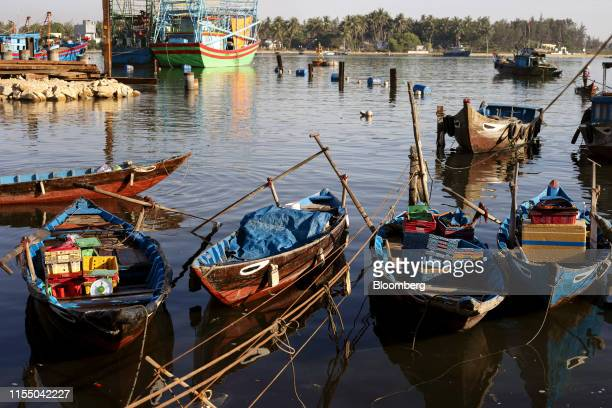 Boats sit moored in Tan Quang harbor in Quang Nam province Vietnam on Wednesday June 26 2019 Fishermen are on the front lines of Asias most complex...