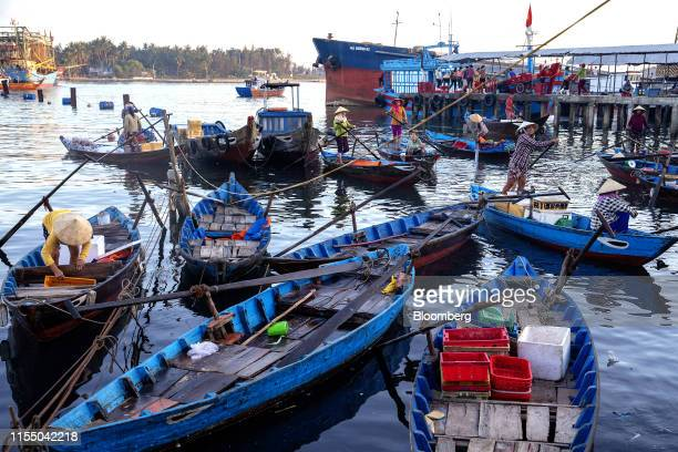 Boats sit moored near Tan Quang market in Quang Nam province Vietnam on Thursday June 27 2019 Fishermen are on the front lines of Asias most complex...
