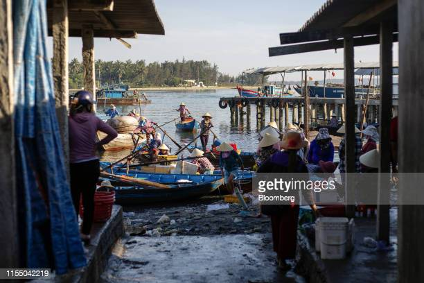 Boats sit moored near Tan Quang market in Quang Nam province Vietnam on Wednesday June 26 2019 Fishermen are on the front lines of Asias most complex...