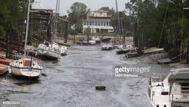 Boats sit on the bottom in the north Florida panhandle community of Shell Point Beach as Hurricane Irma pulls the water out September 11 2017 in...