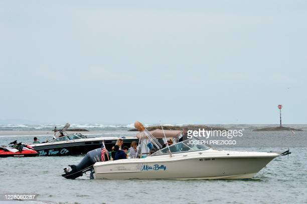Boats sit tied to the shore where boaters relax and barbecue at Wingaersheek Beach in Gloucester Massachusetts on August 15 2020 Over the past summer...