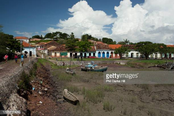 Boats sitting on a dried up riverbed in Alcantara on 27th May 2014, Maranhao, Brazil. It is an island off the north east coast of Brazil close to Sao...