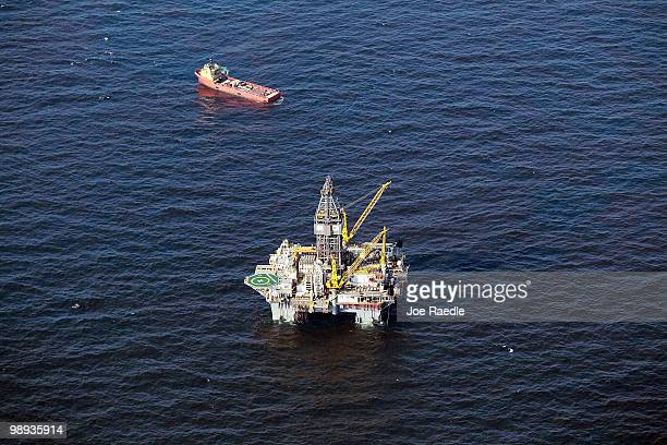 Boats surround the leaking oil from the site where the Deepwater Horizon oil platform sank near a drilling platform as work continues to contain the...