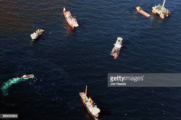 Boats surround the leaking oil from the site where the Deepwater Horizon oil platform sank as work continues to contain the leak on May 9 2010 in the...