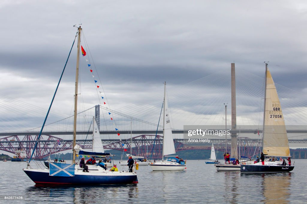 Boats take part in the Queensferry Crossing Flotilla during the official opening on September 4, 2017 in South Queensferry, Scotland. Scotland's newest road bridge which began construction in 2011, crosses the Firth of Forth near Edinburgh. The crossing is the world's longest three tower cable stayed bridge.