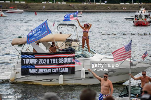 Boats taking part in a boat parade for the reelection of President Donald Trump passes by Point State Park on the Allegheny River on July 4 2020 in...