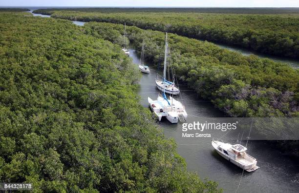 Boats that can't be evacuated are tied off in canals to protect them from Hurricane Irma on September 8 2017 in Key Largo Florida The entire Florida...