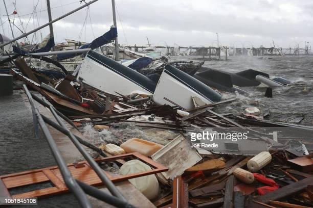 Boats that were docked are seen in a pile of rubble after hurricane Michael passed through the downtown area on October 10 2018 in Panama City...