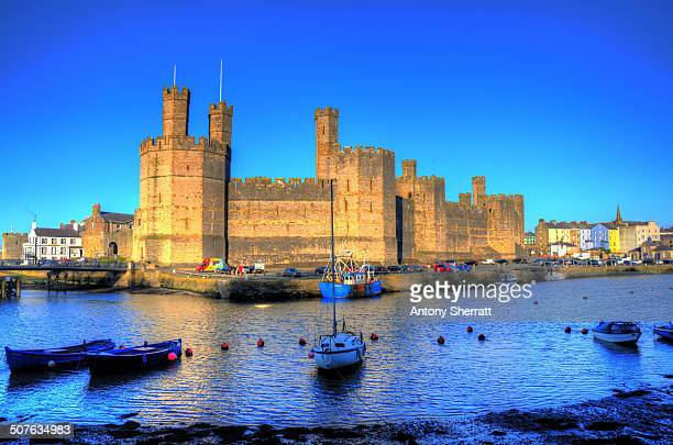 CONTENT] boats tied up in front of caenarfon castle in North Wales