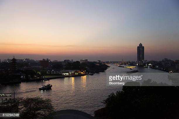 Boats travel along the Chao Phraya river in Bangkok Thailand on Saturday Feb 13 2016 Thailand's gross domestic product probably increased 27 percent...