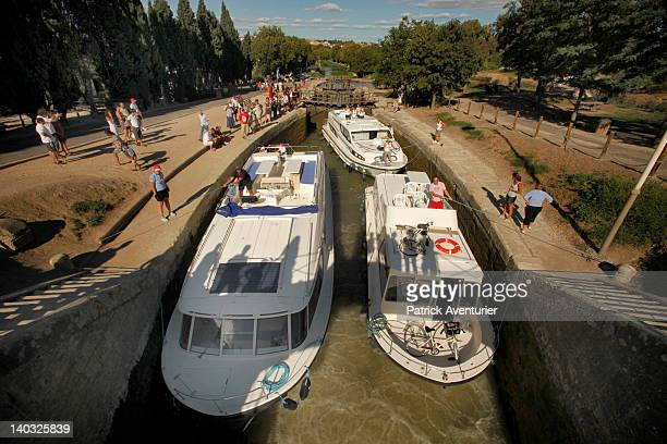 Boats use the Fonseranes lock on the Canal Du Midi on August 27, 2011 in Beziers,France. Approximately 10,000 boats per year use the famous lock of...