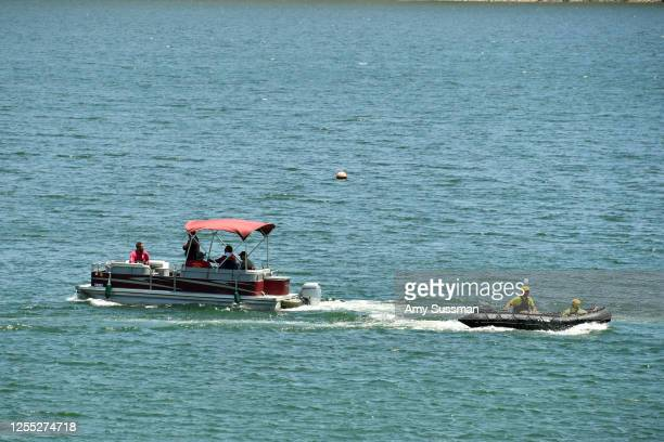 Boats with emergency workers search Lake Piru where actress Naya Rivera was reported missing Wednesday on July 9 2020 in Piru California Rivera known...