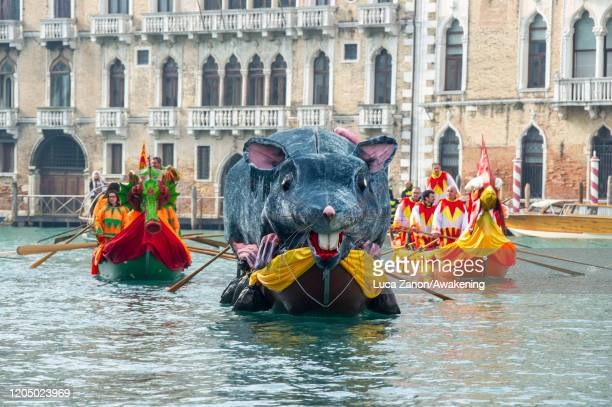Boats with masked revellers sails on the Grand Canal during the traditional regatta which officially opens the Carnival in Venice on February 09 2020...