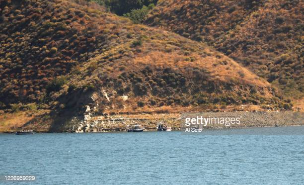 Boats with rescuers gather near a cove on Lake Piru as it is learned Ventura County Sheriffs Search and Rescue dive team located a body Monday...