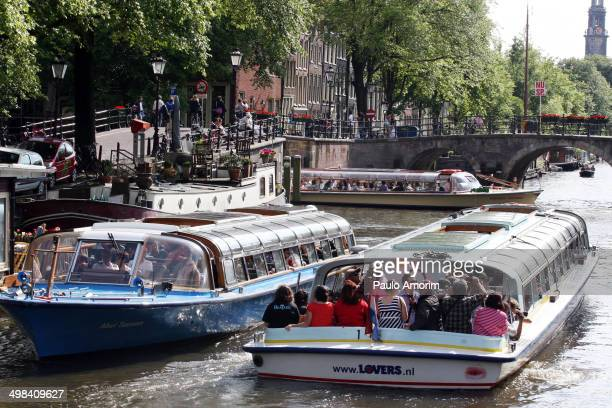 Boats with tourists at canals in Amsterdam,Netherlands