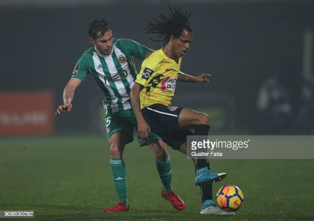 Boavista FC forward Kuca from Cape Verde with Rio Ave FC defender Yuri Ribeiro from Portugal in action during the Primeira Liga match between Rio Ave...