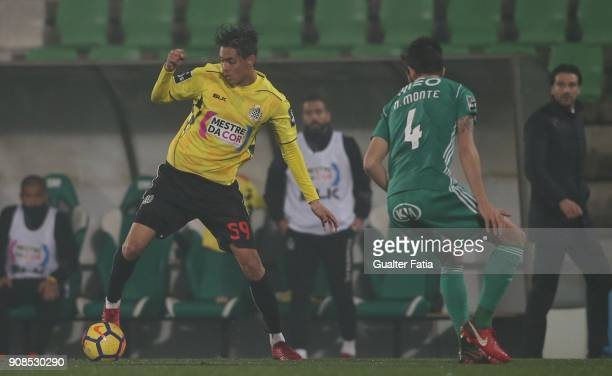 Boavista FC forward Leonardo Ruiz from Colombia with Rio Ave FC defender Nelson Monte from Portugal in action during the Primeira Liga match between...