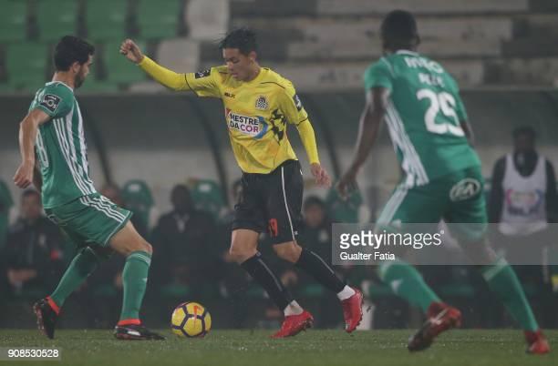Boavista FC forward Leonardo Ruiz from Colombia with Rio Ave FC midfielder Tarantini from Portugal in action during the Primeira Liga match between...