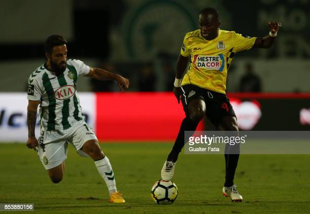 Boavista FC forward Mateus from Angola with Vitoria Setubal midfielder Joao Costinha from Portugal in action during the Primeira Liga match between...