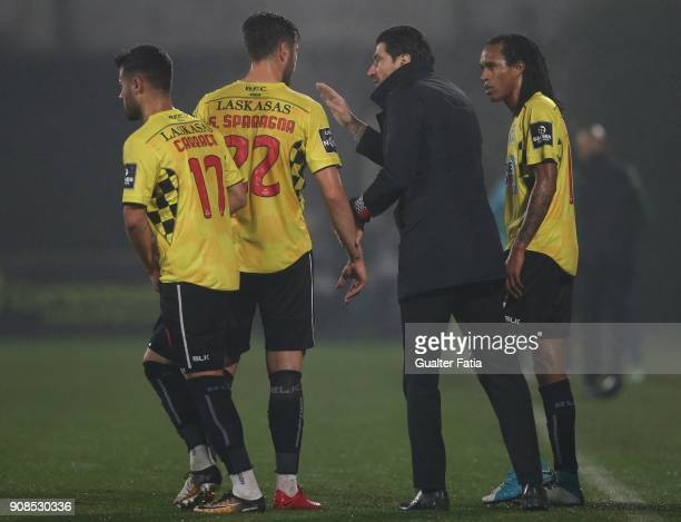 Boavista FC head coach Jorge Simao from Portugal talks to players during the Primeira Liga match between Rio Ave FC and Boavista FC at Estadio dos...