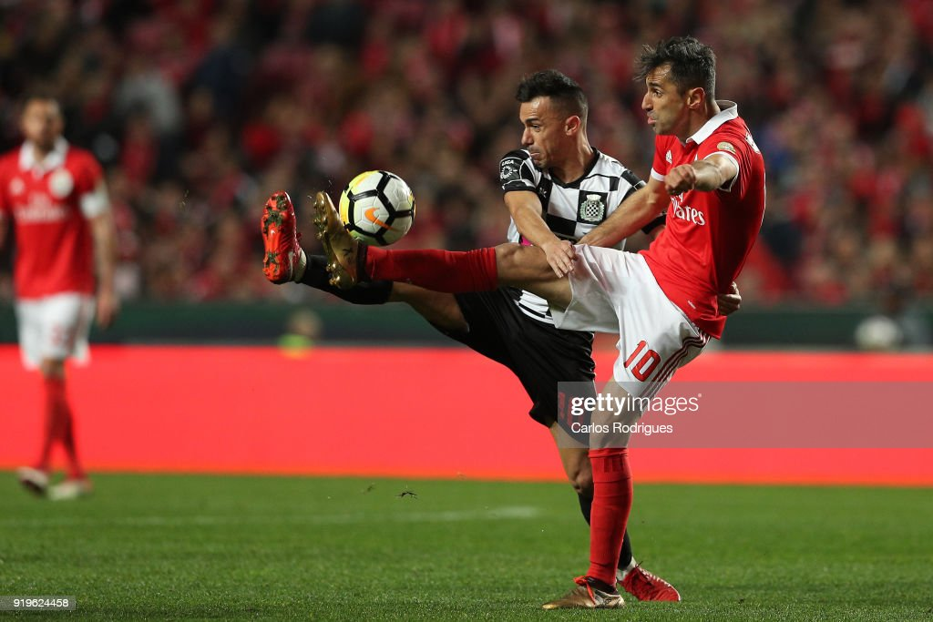 Boavista FC midfielder Fabio Espinho from Portugal (L) vies with SL Benfica forward Jonas from Brasil (R) for the ball possession during the Portuguese Primeira Liga match between SL Benfica and Boavista FC at Estadio da Luz on February 17, 2018 in Lisbon, Lisboa.