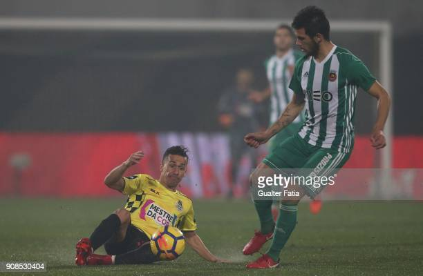Boavista FC midfielder Fabio Espinho from Portugal with Rio Ave FC defender Nelson Monte from Portugal in action during the Primeira Liga match...