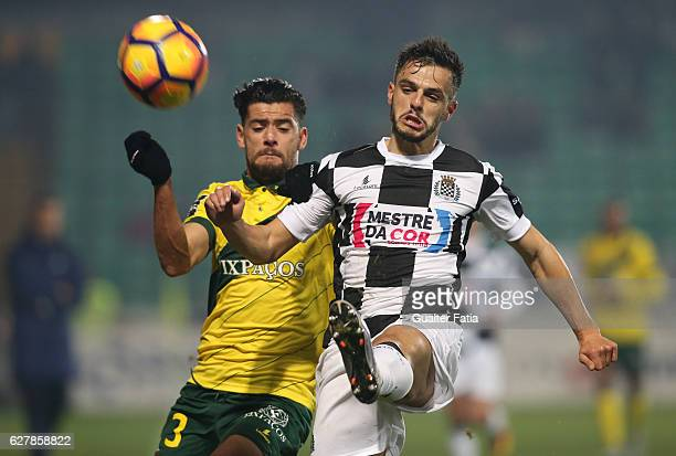 Boavista FCÕs defender Talocha with Pacos Ferreira's forward Ivo Rodrigues from Portugal in action during the Primeira Liga match between Pacos de...