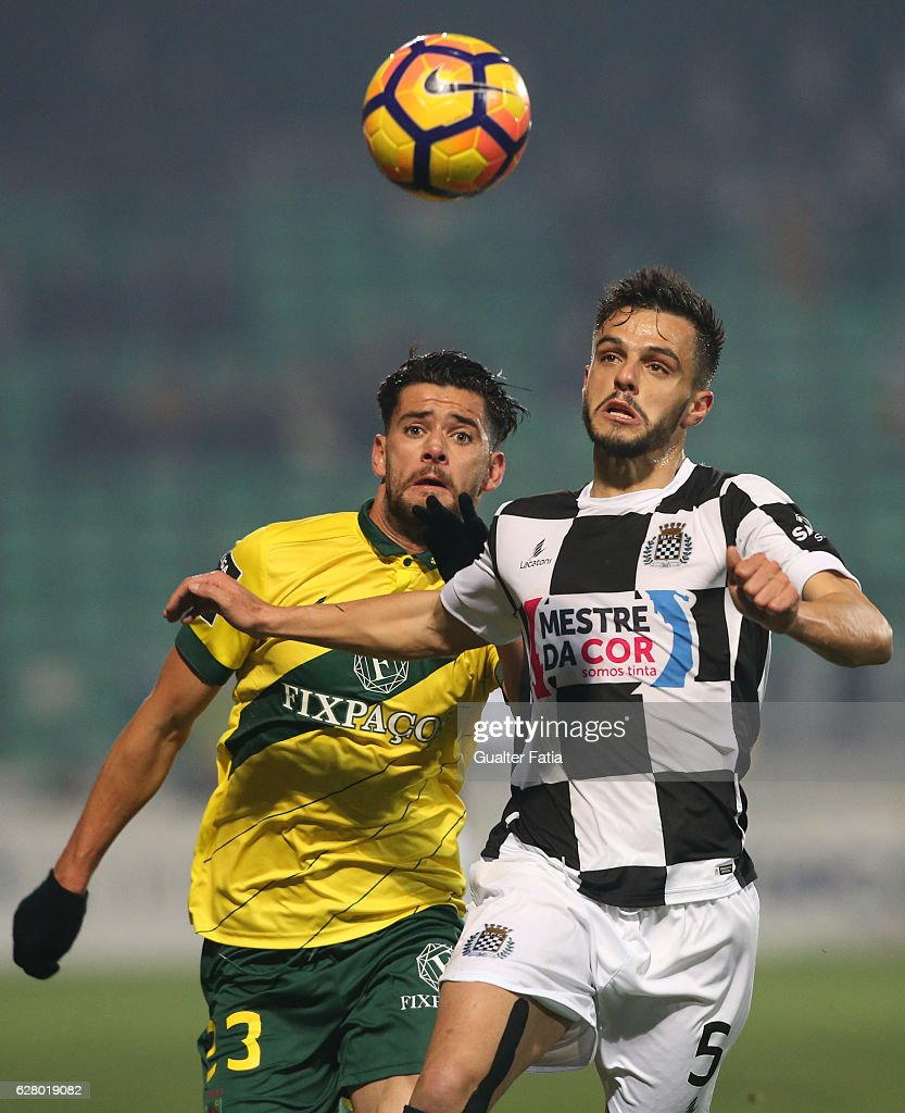 Boavista FC's defender Talocha (R) with Pacos Ferreira's forward Ivo Rodrigues from Portugal (L) in action during the Primeira Liga match between Pacos de Ferreira and Boavista FC at Estadio da Mata Real on December 5, 2016 in Pacos de Ferreira, Portugal.