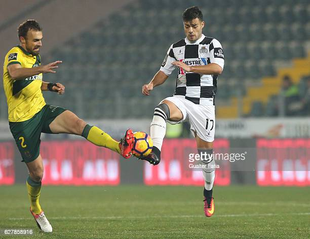 Boavista FCÕs midfielder Carraca with Pacos Ferreira's midfielder Marco Baixinho from Portugal in action during the Primeira Liga match between Pacos...